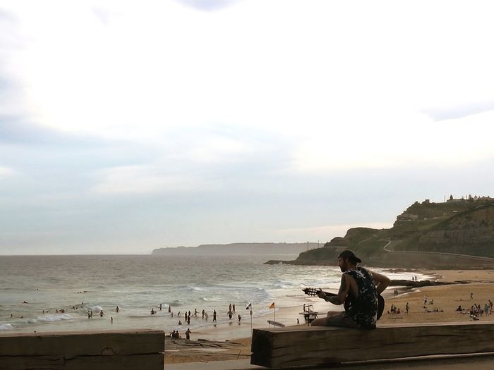 Guitar at Newcastle beach Beach Sea Water Sand People Nature Sky Outdoors Lifestyles One Person Wave