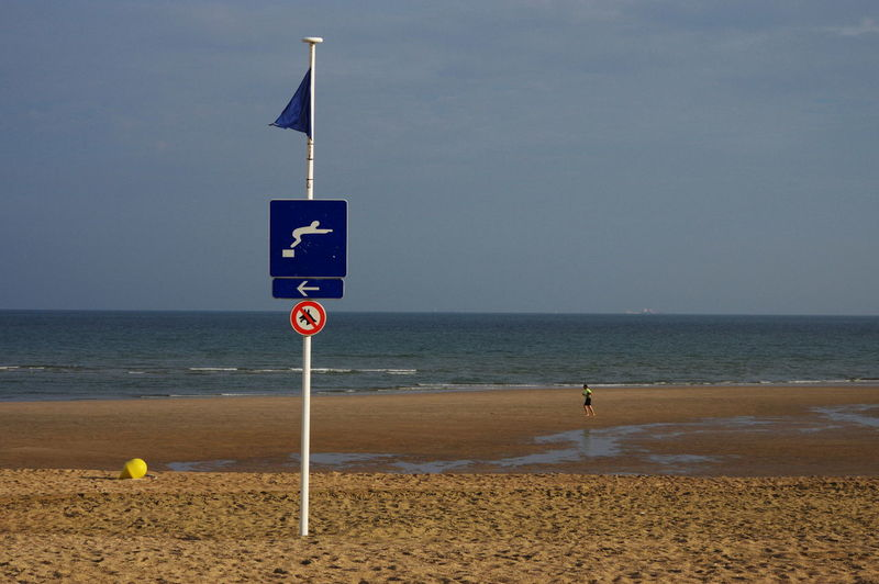 BEACH SIGNS Beach Communication Horizon Over Water No People Outdoors Sand Sea Sign Tranquility Water