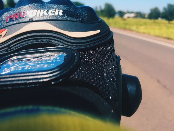 Close-up Focus On Foreground Day No People Transportation Security Clothing Protection Black Color Outdoors Sports Equipment Mode Of Transportation Nature Selective Focus Equipment Sunlight Helmet Car Road Still Life