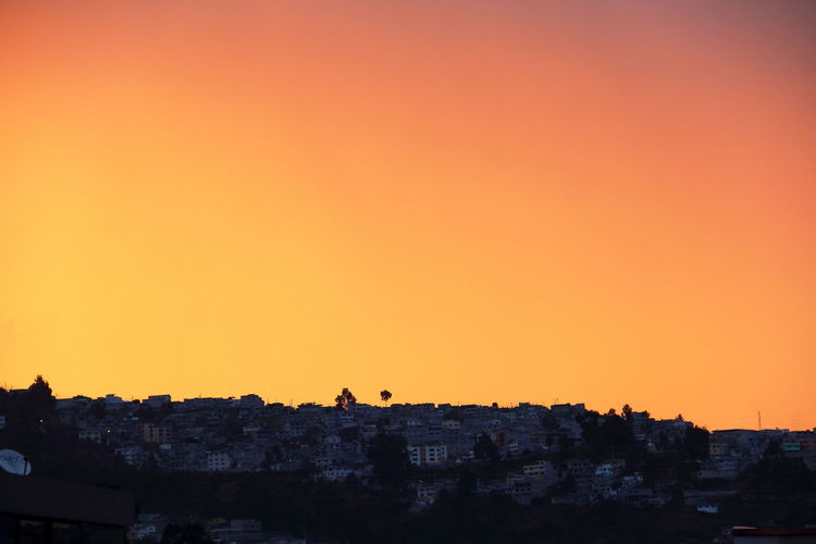 Buildings On Mountain Against Clear Sky During Sunset