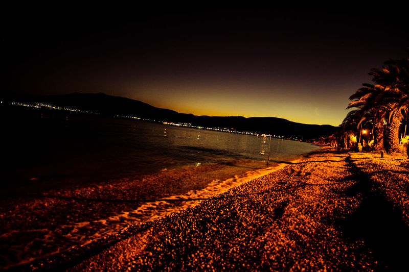 Beach Beauty In Nature Clear Sky Illuminated Mountain Nature Night No People Outdoors Scenics Sea Silhouette Sky Sunset Tranquil Scene Tranquility Water