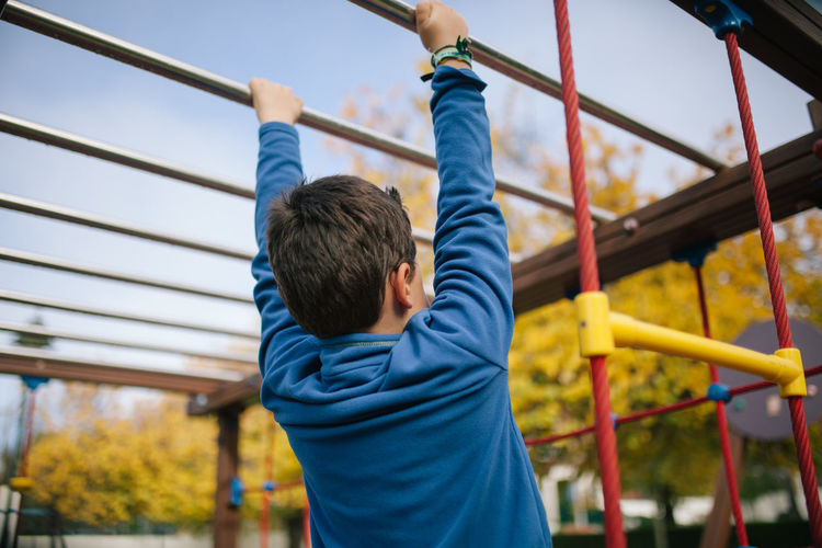 Kid Kids Kids Being Kids Kids Playing Park Park - Man Made Space Enjoying Life Childhood Innocence Arms Raised Outdoor Play Equipment Jungle Gym Playground Lifestyles Casual Clothing Leisure Activity Rear View Boys Real People Child Day Moments Of Happiness 17.62°