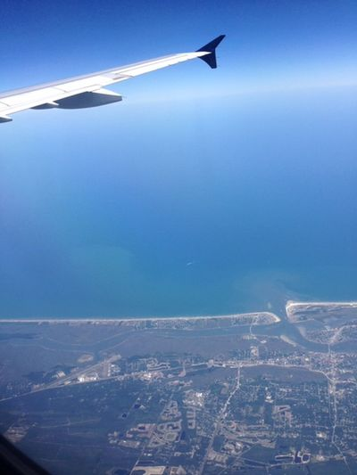 Airplane Aircraft Wing Aerial View Mode Of Transportation Sky on the move Travel Blue Outdoors Journey Cityscape Aerospace Industry Air Vehicle Coastline Coast