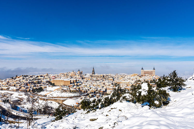 View of townscape against blue sky during winter