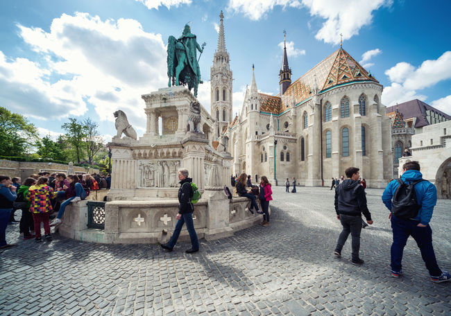 Budapest, Hungary-april 15, 2014: View of St. Stephen Statue and Matthias Church at Fishermen's Bastion, is one of the most-visited attractions in Budapest, on 15 april 2014 Buda Budapest Budapest, Hungary Horse Statue Hungary Matthias Church Memorial Sightseeing Square St. Stephen Statue Statue Tourist Bronze Statue Crowd Of People Equestrian Fisherman's Bastion Historic History Hungarian Landmark Monument Outdoors Sculpture Sunny Day Tourism