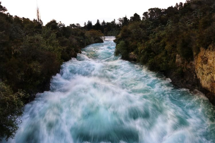 New Zealand Huka Falls Huka Falls, NZ Water Rapids White Water Rapids  White Water Blue colour of life Stormy Weather Stormy Sky Storm Clouds Sunset Nature No People Scenery New Zealand Scenery Motion Beauty In Nature Tree Scenics - Nature Plant Flowing Water Blurred Motion Sport Long Exposure Forest Aquatic Sport Waterfall River Flowing Speed Outdoors Power In Nature