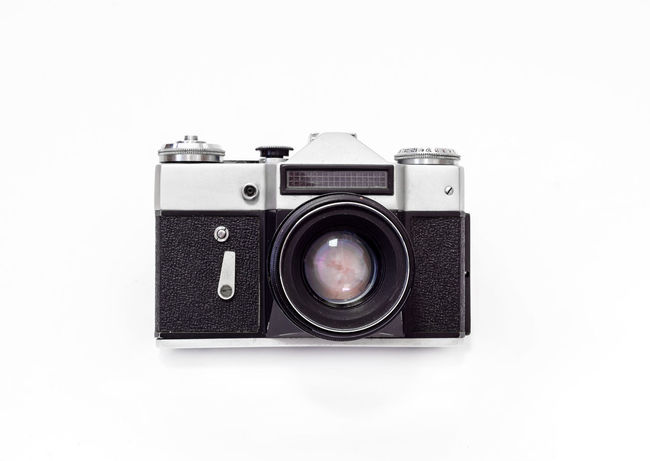 Activity Antique Camera - Photographic Equipment Chrome Copy Space Cut Out Digital Camera Indoors  Lens - Eye Lens - Optical Instrument Modern No People Old Photographic Equipment Photographing Photography Themes Retro Styled Silver Colored Simplicity Single Object SLR Camera Studio Shot Technology White Background White Color