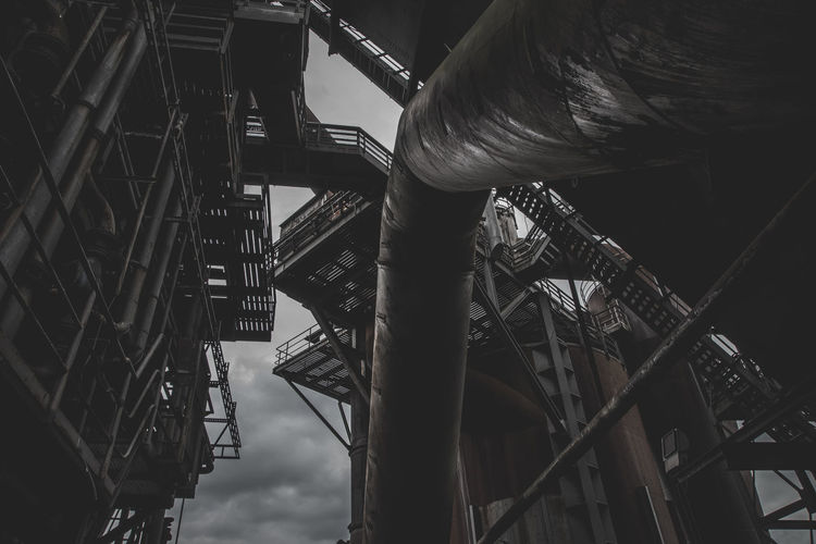 Urbex - 12 Industry Low Angle View Built Structure Architecture Metal Factory Day Building Exterior Construction Industry Machinery Outdoors No People Construction Site Crane - Construction Machinery Iron - Metal Incomplete Industrial Building  Manufacturing Equipment Nature Industrial Equipment