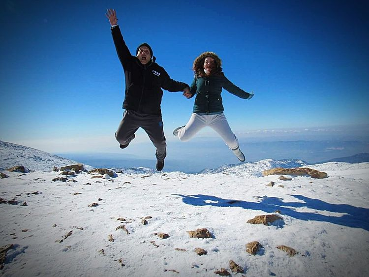 Winter Snow Vitality Enjoyment Happiness People Beauty In Nature Jump! Jumpstyle Cold Temperature Fun Two People Wintertime Mountains And Sky This Is Family