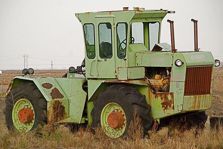 Tractor Abandoned Rusty Green Color Field