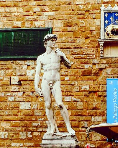 David copy of Micheal Angelo Sculpture Statue Human Representation Art And Craft Male Likeness Creativity Architecture Built Structure Building Exterior Brick Wall Wall