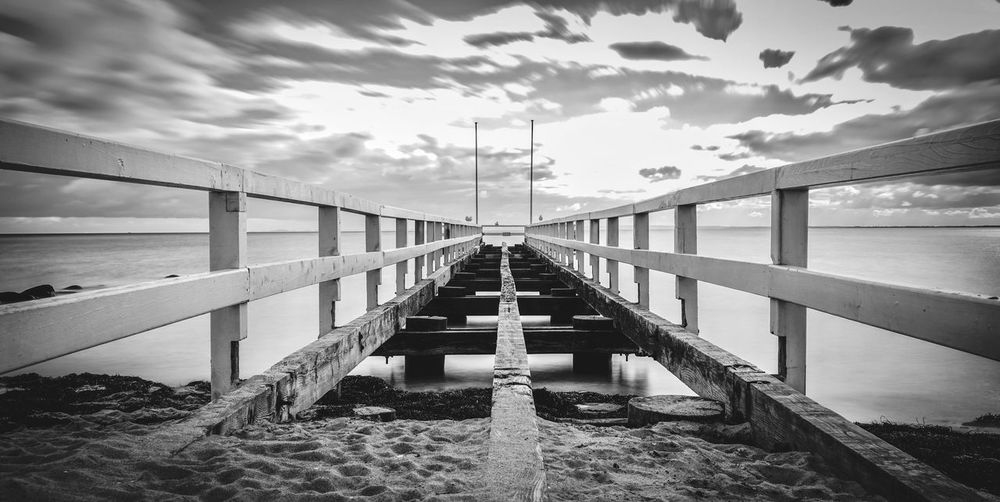 EyeEm Best Shots First Eyeem Photo Fine Art Photography Weathered Damaged Monochrome Schwarzweiß Blackandwhite Cloud - Sky Water Sky Built Structure Architecture Nature Railing Sea Bridge Connection The Way Forward No People Bridge - Man Made Structure Diminishing Perspective Outdoors Pier Day Direction