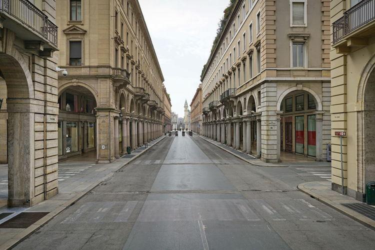 Empty street amidst buildings in city