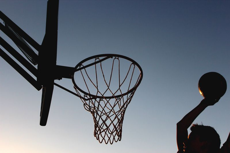 Man Playing Basketball Against Sky