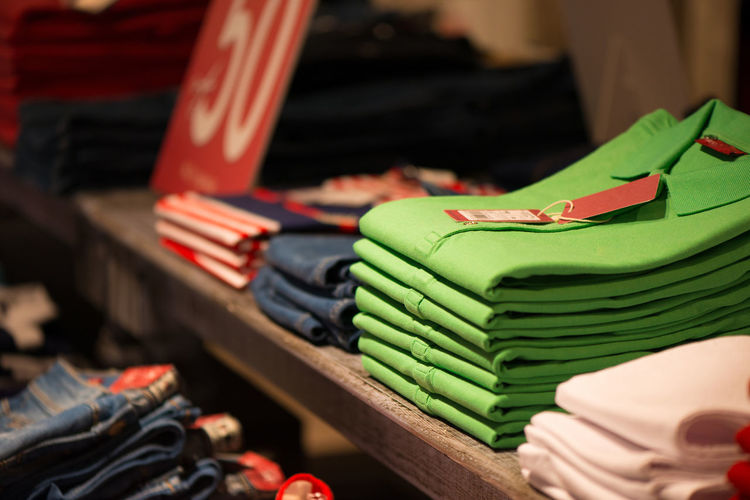 Close-up of shirts on shelf for sale at store