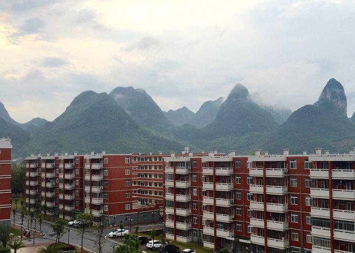 Mountain range against cloudy sky