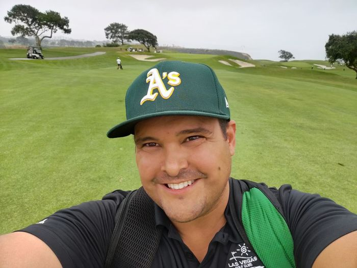 Portrait of smiling man on golf course