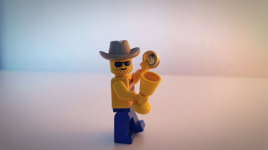 EyeEm Selects Toy Fun Looking At Camera Indoors  Tiger One Person Day Legoman George Sexdrugsandrocknroll Money Money Money Drinking Glasses On