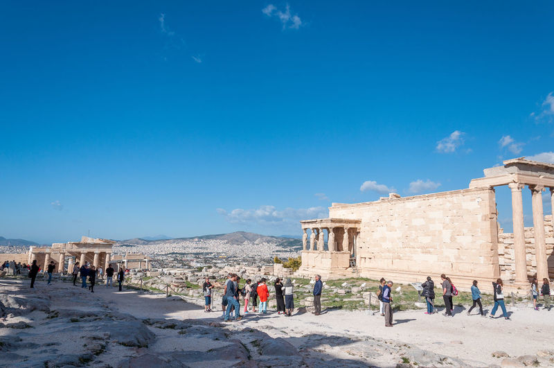 Tourists walking in the acropolis