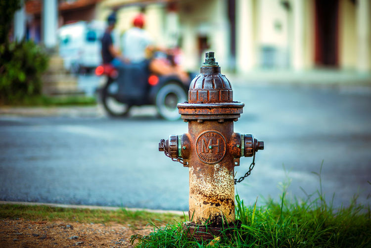 Old Fire Hydrant Against Street