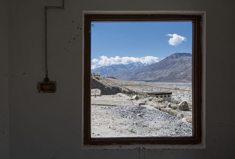 View of landscape seen through window