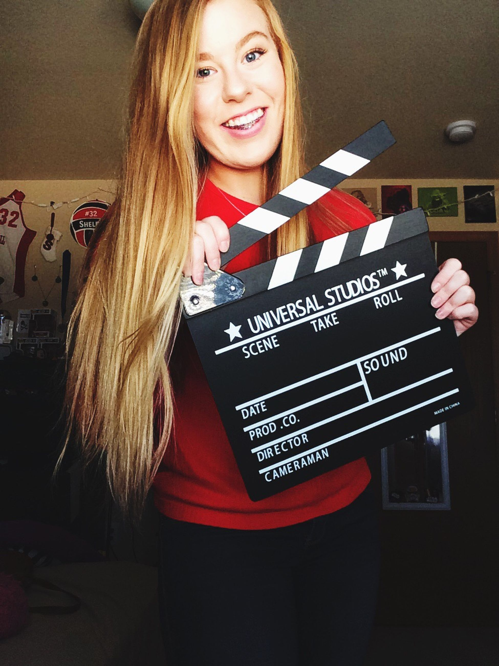 smiling, blond hair, toothy smile, red, long hair, blackboard, christmas, cheerful, excitement, happiness, portrait, beautiful people, one person, indoors, standing, people, film industry, beautiful woman, adult, adults only
