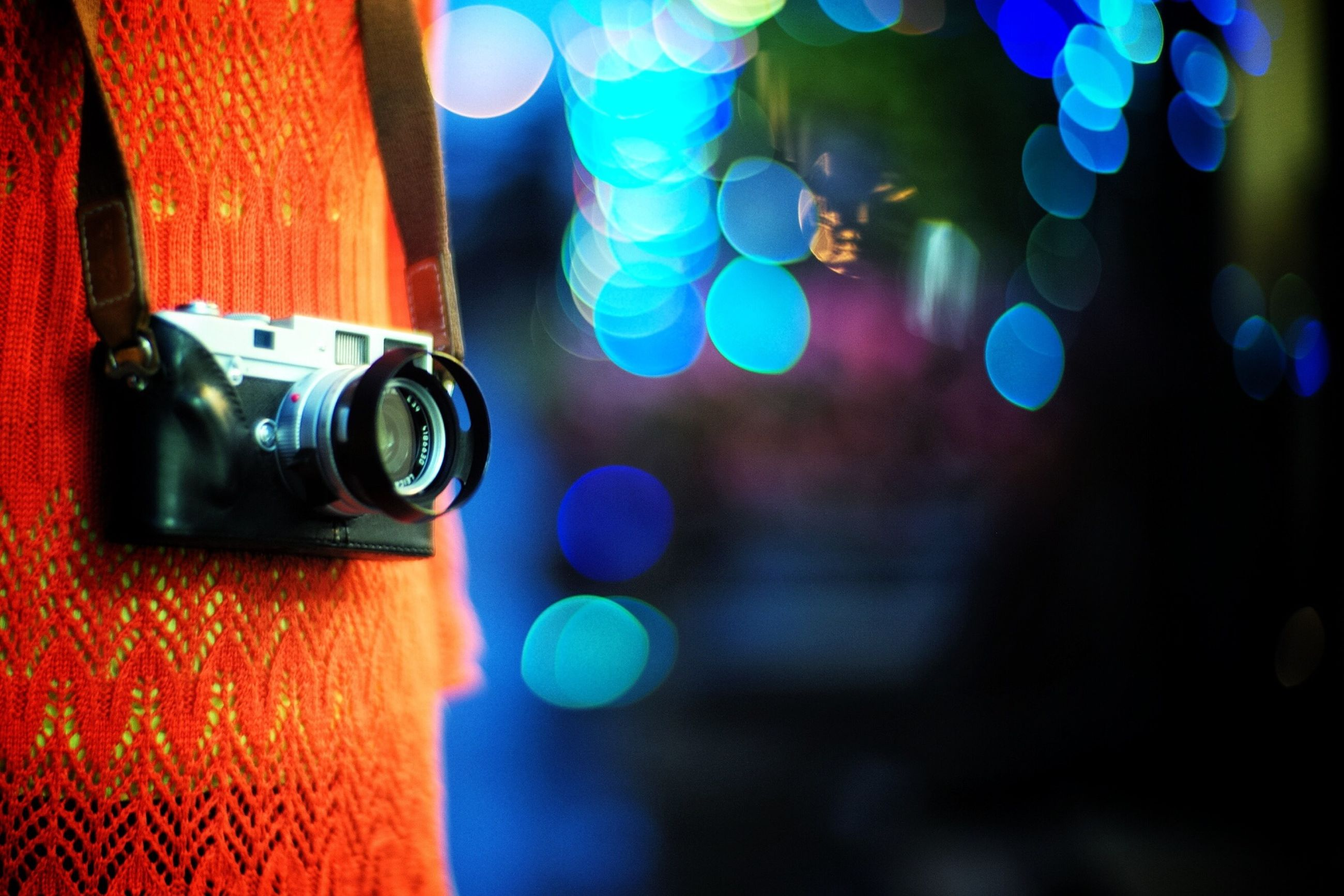 focus on foreground, close-up, illuminated, multi colored, selective focus, defocused, lens flare, land vehicle, part of, lighting equipment, no people, outdoors, night, blue, car, glass - material, street, reflection, sunlight