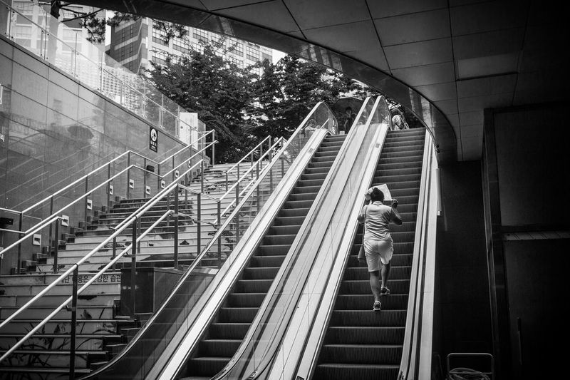 Adult Adults Only Architecture Blackandwhite Built Structure Casual Clothing Day Full Length Futuristic Indoors  Leisure Activity Lifestyles Men People Railing Rain Real People Rear View Staircase Steps Steps And Staircases Technology Walking Women Live For The Story The Street Photographer - 2017 EyeEm Awards
