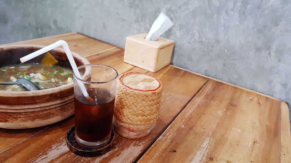 EyeEm Selects Thai traditional meal set with iced drink Indoors  No People Wood - Material Food And Drink High Angle View Freshness Close-up Day Cousine  Meal Mealtime Wooden Table Raw Concrete Loft Wall Bamboo Basket Bucket Iced Drink Decoration Glass And Straw