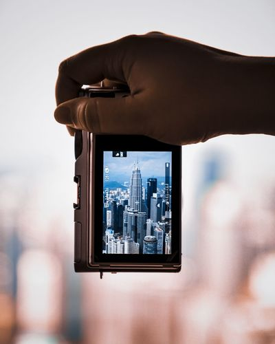 The twin tower Human Hand City Cityscape Photography Themes Technology Wireless Technology Photographing Modern Business Finance And Industry Communication Office Building Tall - High Tower Skyscraper