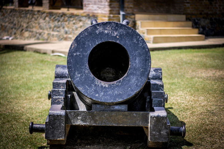 Close-up of cannon on grass