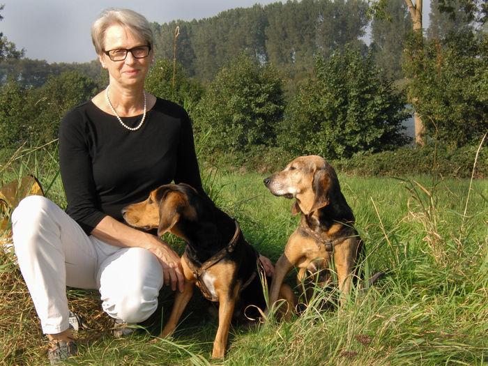 Woman, Käthe and Hedda Alberta Nestone Hedda Animal Themes Canine Dog Domestic Grass Käthe One Animal Pets Plant Portrait