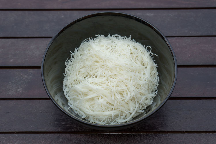 High angle view of rice in bowl on table