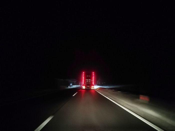 Truck at night Backlight Truck City Illuminated Red Road Stoplight Speed Long Exposure Danger Light Trail Red Light Vehicle Light Tail Light Headlight Traffic