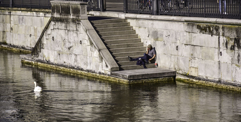 Adult Adults Only Architecture Built Structure Day Full Length Lake Leisure Activity Lifestyles Men Nature One Man Only One Person Only Men Outdoors People Real People Rowing Sitting Steps Water Young Adult