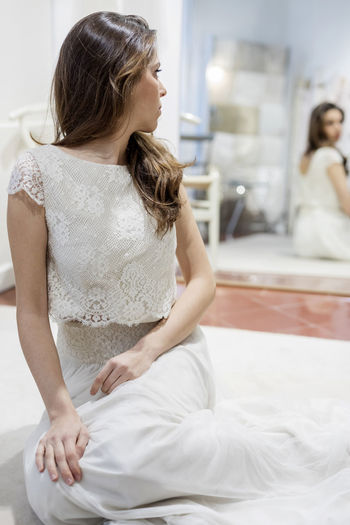 Dress Beautiful Mirror Sitting Bride Young Woman White Wedding Girl Fashion Hair Model Attractive Pretty Female Lace Beauty Vintage Caucasian Elegant Lady Portrait Studio Background Wedding Dress Happy person Floor Cute Reflection Ring Adult Sit Jewelry Advertising Makeup Interior Retro Brunette Fashionable Blonde Hair Bridal Ground Women Real People Lifestyles Indoors  Young Adult Domestic Room Young Women Furniture People Home Interior Looking Hairstyle Event Beautiful Woman