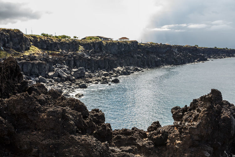 Azores Pico Island Basaltic Rock Beach Beauty In Nature Cloud - Sky Day Dog Rocks Eroded Land Nature No People Non-urban Scene Outdoors Rock Rock - Object Rock Formation Rocky Coastline Scenics - Nature Sea Sky Solid Tranquil Scene Tranquility Water