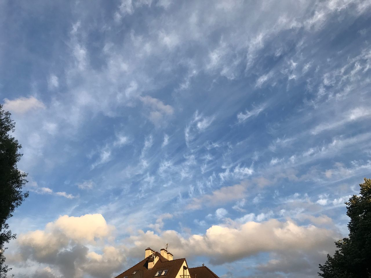 cloud - sky, sky, low angle view, outdoors, day, no people, architecture, nature, built structure, beauty in nature, scenics, building exterior, tree