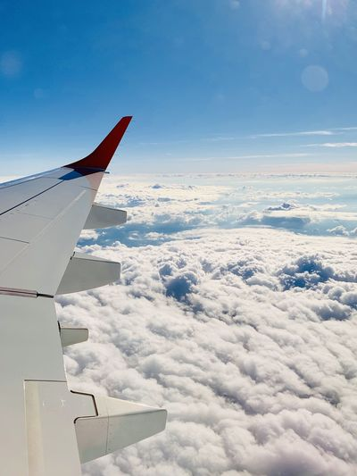 Cloud - Sky Sky Air Vehicle Airplane Mode Of Transportation Transportation Aircraft Wing Flying Nature No People Travel Beauty In Nature Cloudscape Day Mid-air Scenics - Nature Outdoors Blue Motion Winglet Wingview Wing View