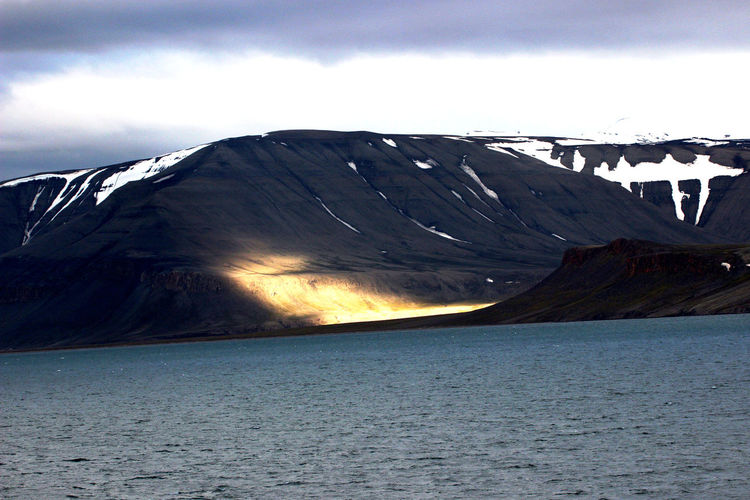 Norway🇳🇴 Spitzbergen Sunshine And Shadows Beauty In Nature Cloud - Sky Mountain Non-urban Scene Scenics - Nature Tranquil Scene