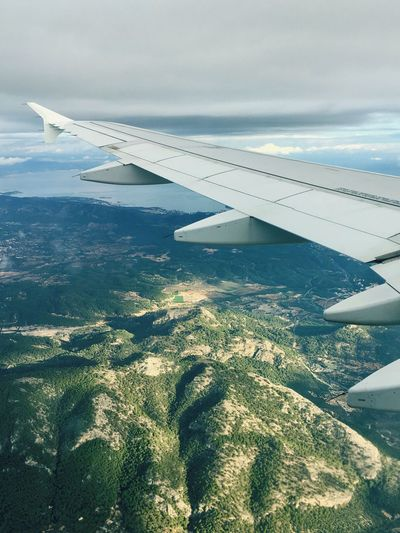 Lost In The Landscape Aerial View Airplane Nature Landscape Aircraft Wing Day No People Beauty In Nature Air Vehicle Airplane Wing Transportation Journey Travel Tranquility Mid-air Scenics Outdoors Sky Flying Perspectives On Nature