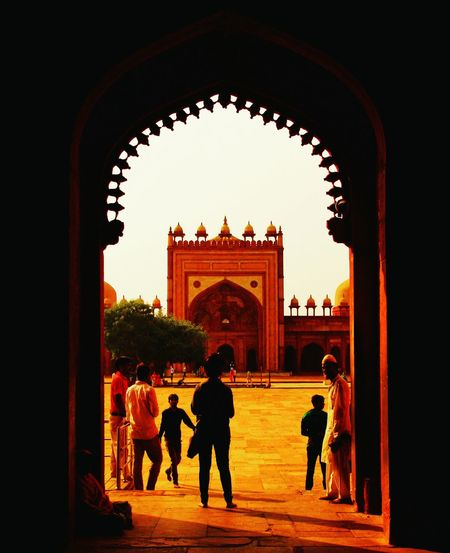 Through the window Fatehpur Sikri Bulanddarwaza Shadows & Lights Patterns Everywhere Silhouette Arch Gate People Travel Destinations Full Length Adult Outdoors Candidshot Young Adult EyeEm Selects Monument Built Structure