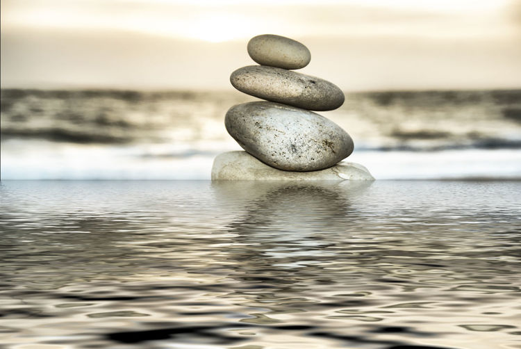 Stone tower on the beach in Denmark Balance Beginnings Depth Of Field Floating On Water Lake No People Organic Outdoors Pebble Reflection Ripe Rippled Selective Focus Shiny Stack Stone Stone - Object Swimming Water Water Surface Waterfront