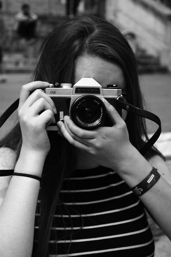 Photography Themes Camera - Photographic Equipment Front View Photography Themes Camera - Photographic Equipment Close-up Focus On Foreground Holding Young Adult Person Outdoors Memories Monochrome Photography