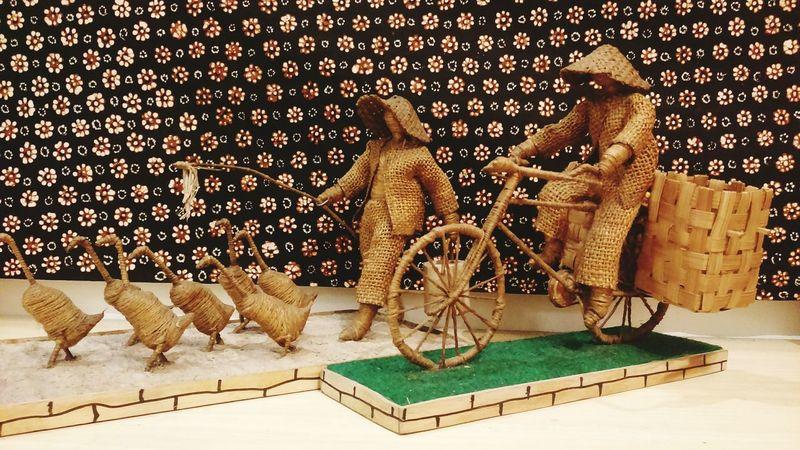 Rough Fabric and Bamboo Crafts in front of Batik Batik Tulis motif Truntum Pattern INDONESIA Great Art