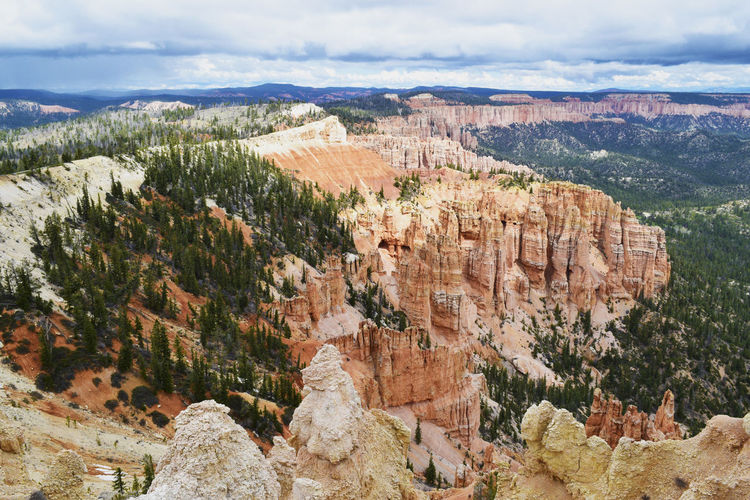 Rock formations at bryce canyon national park against cloudy sky