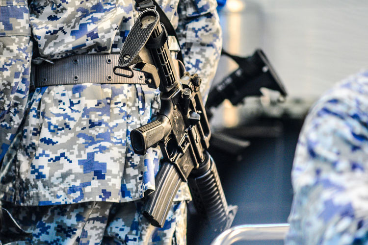 Pattern Military Low Section Machinery Men Technology Selective Focus One Person Close-up Metal Security Army Government Rifle Camouflage