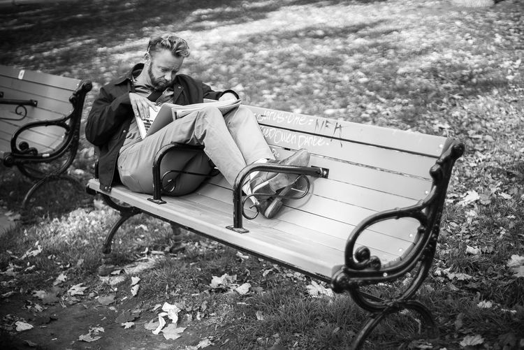 Autumn Lunch Park Bench Black And White Break Time Casual Clothing Day Documentary Full Length Leaves Leisure Activity Lifestyles Nature One Person Outdoors People Real People Relaxation Sitting Streetphotography Tree Young Men Bnw_collection The Street Photographer - 2018 EyeEm Awards The Art Of Street Photography