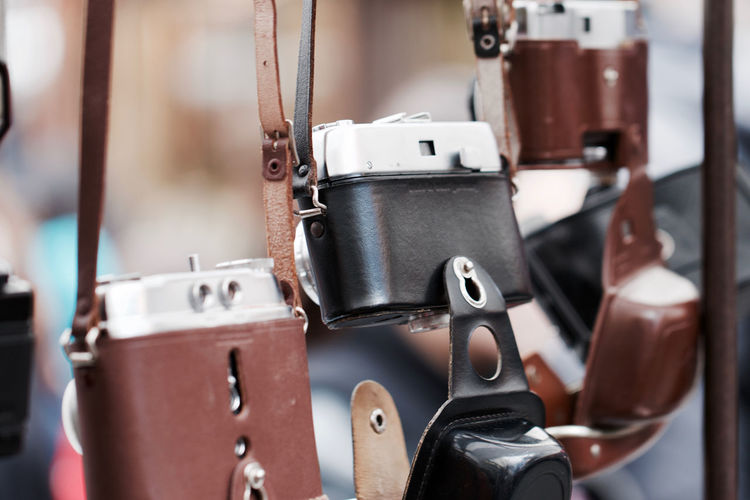 Old retro styled cameras hanging outdoors