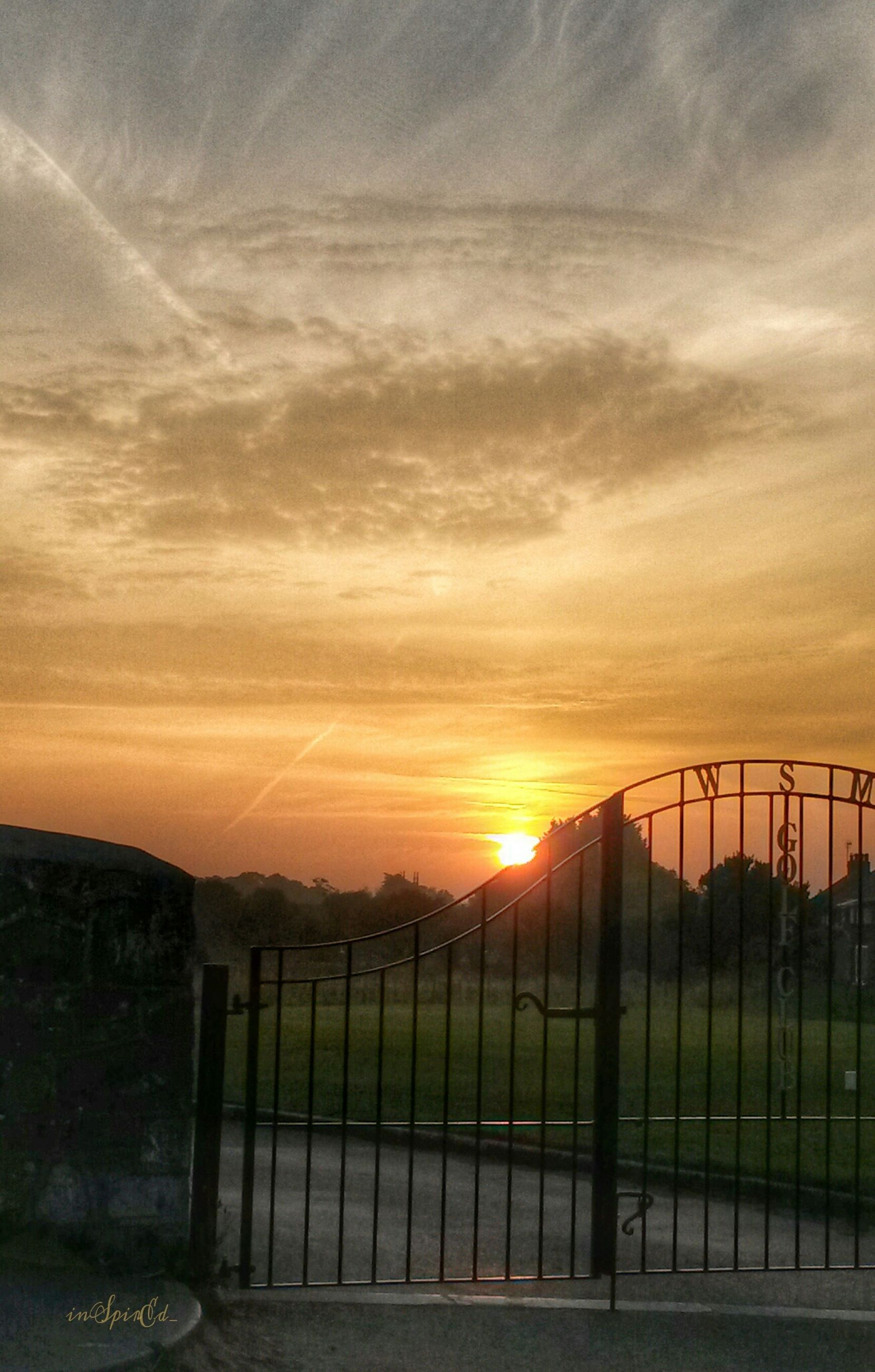 sunset, fence, sky, orange color, sun, safety, railing, protection, cloud - sky, scenics, tranquility, tranquil scene, landscape, beauty in nature, security, built structure, sunlight, nature, idyllic, architecture
